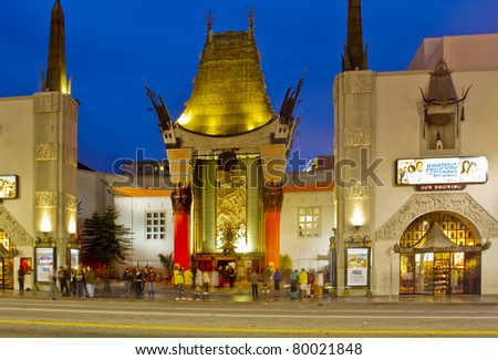 LOS ANGELES - MAY 17: Tourists congregate in front of Grauman's Chinese Theater on May 17, 2011 in Los Angeles. The theater is famous for it's celebrity hand prints cast in concrete on Hollywood Blvd.