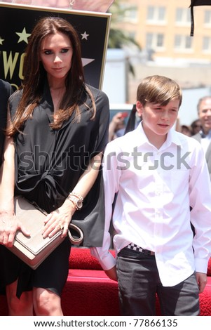 LOS ANGELES - MAY 23:  Victoria Beckham, Son Brooklyn Beckham at the Simon Fuller Hollywood Walk Of Fame Star Ceremony at W Hotel - Hollywood on May 23, 2011 in Los Angeles, CA
