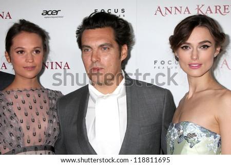 LOS ANGELES - NOV 14:  Alicia Vikander. Joe Wright, Keira Knightley arrives to the 'Anna Karenina' Los Angeles Premiere at ArcLight Hollywood on November 14, 2012 in Los Angeles, CA