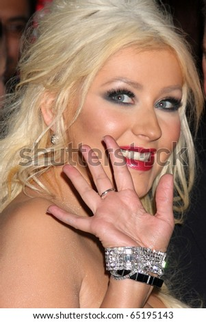 """LOS ANGELES - NOV 15: Christina Aguilera arrives at the """"Burlesque&quo t; LA Premiere  at Grauman's Chinese Theater on November 15, 2010 in Los Angeles, CA - stock photo"""