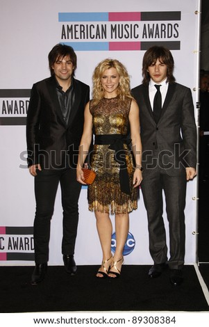LOS ANGELES - NOV 20: Reid Perry; Kimberly Perry; Neil Perry of The Band Perry at the 2011 American Music Awards Press Room at Nokia Theatre L.A. Live on November 20, 2011 in Los Angeles, California