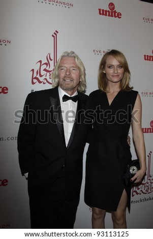LOS ANGELES - NOV 16: Richard Branson; Amber Valletta at the 5th annual 'Rock the Kasbah' in support of Virgin Unite and the Eve Branson Foundation on November 16, 2011 in Los Angeles, California - stock photo