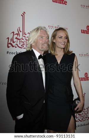 LOS ANGELES - NOV 16: Richard Branson; Amber Valletta at the 5th annual 'Rock the Kasbah' in support of Virgin Unite and the Eve Branson Foundation on November 16, 2011 in Los Angeles, California