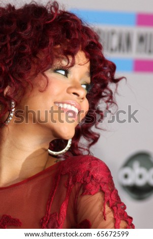 LOS ANGELES - NOV 21:  Rihanna arrives at the 2010 American Music Awards at Nokia Theater on November 21, 2010 in Los Angeles, CA - stock photo