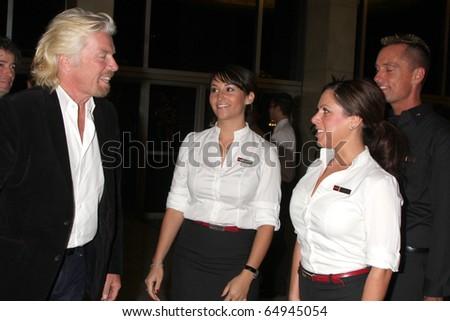 LOS ANGELES - NOV 11:  Sir Richard Branson, Virgin America Flight Attendants arrives at the Rock the Kabash Gala 2010 at Dorothy Chandler Pavilion  on November 11, 2010 in Los Angeles, CA