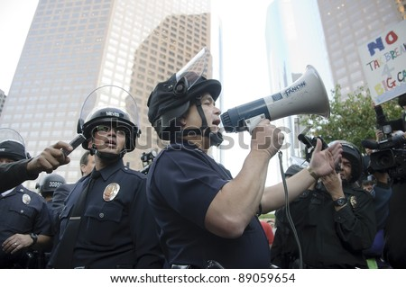 LOS ANGELES - NOVEMBER 17: Police officer's  reportage at Occupy LA protesters march in Los Angeles on November 17, 2011.