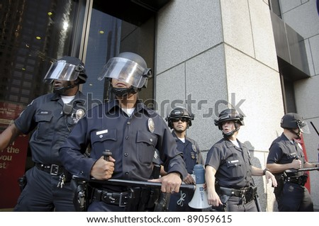 LOS ANGELES - NOVEMBER 17: Riot police stand guard outside a building of Bank of America during a Occupy LA rally on November 17, 2011 in Los Angeles, CA.