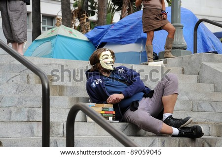 LOS ANGELES - NOVEMBER 14: Unidentified man protester at Occupy LA camping village against the City Hall in Los Angeles on November 14, 2011. - stock photo