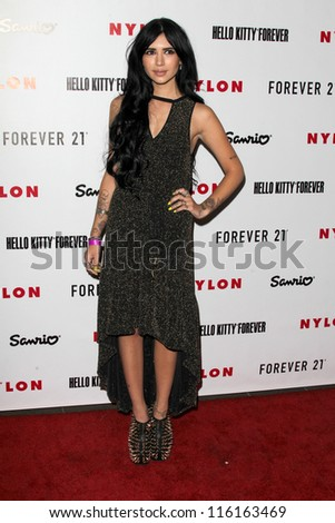 LOS ANGELES - OCT 15:  Hanna Beth arrives at  Nylon's October IT Issue party at London West Hollywood on October 15, 2012 in Los Angeles, CA