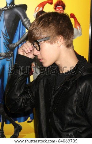 """LOS ANGELES - OCT 30:  Justin Bieber arrives at the """"Megamind&quot ; LA Premiere & Halloween Extravaganza at Mann's Chinese Theater on October 30, 2010 in Los Angeles, CA - stock photo"""