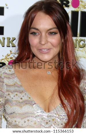 """LOS ANGELES - OCT 11:  Lindsay Lohan arrives at the """"Mr. Pink"""" Energy Drink Launch at Beverly Wilshire Hotel on October 11, 2012 in Beverly Hills, CA - stock photo"""