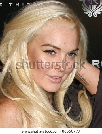 "LOS ANGELES - OCT 12:  Lindsay Lohan arriving at the ""Saints Row: The Third"" Video Game Launch at the Supper Club on October 12, 2011 in Los Angeles, CA"
