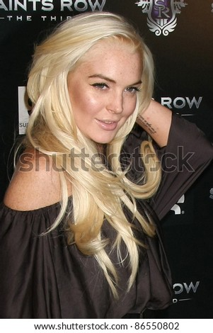 """LOS ANGELES - OCT 12:  Lindsay Lohan arriving at the """"Saints Row: The Third"""" Video Game Launch at the Supper Club on October 12, 2011 in Los Angeles, CA"""