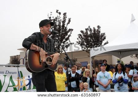 "LOS ANGELES - OCT 16:  Mark Ballas at the Habitat for Humanity San Fernando/Santa Clarita Valley's ""American Dream Walk""  at Pacoima Plaza on October 16, 2010 in Pacoima, CA"