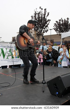 "LOS ANGELES - OCT 16:  Mark Ballas at the Habitat for Humanity San Fernando/Santa Clarita Valley's ""American Dream Walk""  at Pacoima Plaza on October 16, 2010 in Pacoima, CA"