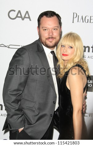 LOS ANGELES - OCT 11: Michael Gladis, Beth Behrs at amfAR's Inspiration Gala at Milk Studios on October 11, 2012 in Los Angeles, California.