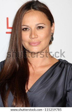"""LOS ANGELES - OCT 10:  Moon Bloodgood arrives at the """"The Sessions"""" Los Angeles Premiere at Bing Theater at Los Angeles Museum of Art on October 10, 2012 in Los Angeles, CA - stock photo"""
