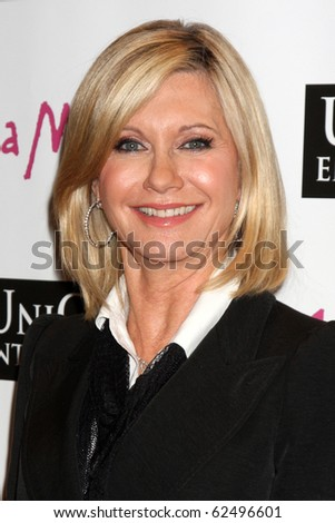 """LOS ANGELES - OCT 6:  Olivia Newton-John arrives at the """"1 a Minute"""" Live Event at Woodbury University on October 6, 2010 in Burbank, CA"""