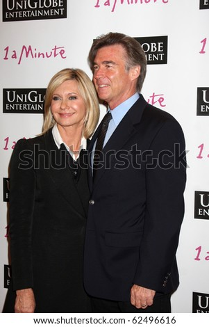 """LOS ANGELES - OCT 6:  Olivia Newton-John & Husband John Easterling arrive at the """"1 a Minute"""" Live Event at Woodbury University on October 6, 2010 in Burbank, CA"""