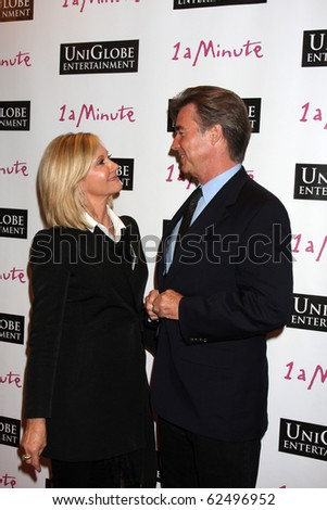 "LOS ANGELES - OCT 6:  Olivia Newton-John & Husband John Easterling arrive at the ""1 a Minute"" Live Event at Woodbury University on October 6, 2010 in Burbank, CA"