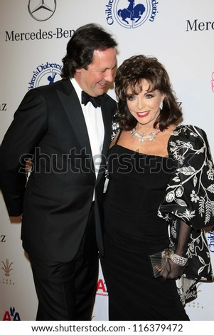 LOS ANGELES - OCT 20:  Percy Gibson, Joan Collins arrives at  the 26th Carousel Of Hope Ball at Beverly Hilton Hotel on October 20, 2012 in Beverly Hills, CA