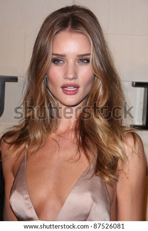 LOS ANGELES - OCT 26: Rosie Huntington-Whiteley arriving at the Burberry Body Launch at Burberry on October 26, 2011 in Beverly Hills, CA - stock photo