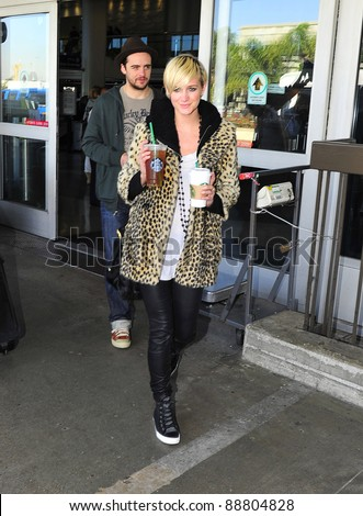 LOS ANGELES-OCTOBER 30 : Singer Ashlee Simpson with boyfriend  at LAX airport. October 30 in Los Angeles, California 2011