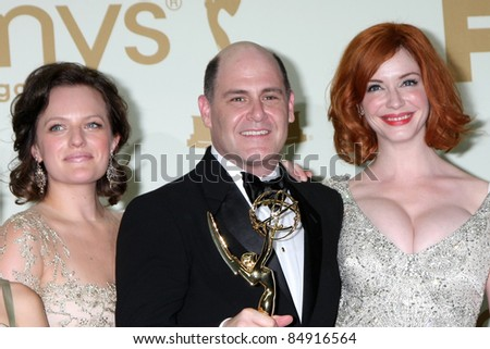 LOS ANGELES - SEP 18:  Elisabeth Moss, Matthew WEiner, Cara Buono in the Press Room at the 63rd Primetime Emmy Awards at Nokia Theater on September 18, 2011 in Los Angeles, CA