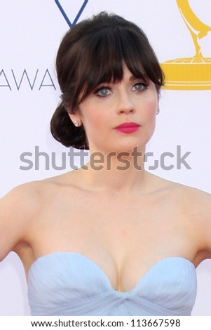 LOS ANGELES - SEP 23:  Zooey Deschanel arrives at the 2012 Emmy Awards at Nokia Theater on September 23, 2012 in Los Angeles, CA