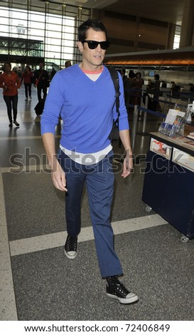 LOS ANGELES - SEPTEMBER 23: Actor Johnny Knoxville is seen at LAX . September 23rd 2010 in Los Angeles, California