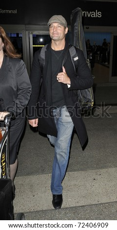 LOS ANGELES - SEPTEMBER 23: Actor Josh Holloway is seen at LAX . September 23rd 2010 in Los Angeles, California