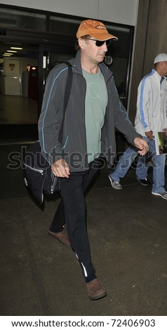LOS ANGELES - SEPTEMBER 23: Actor Liam Neeson is seen at LAX . September 23rd 2010 in Los Angeles, California