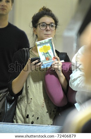 LOS ANGELES - SEPTEMBER 13: Actress Shenae Grimes is seen at LAX . September 13th 2010 in Los Angeles, California
