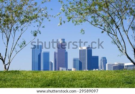 Los Angeles skyline against blue sky background.