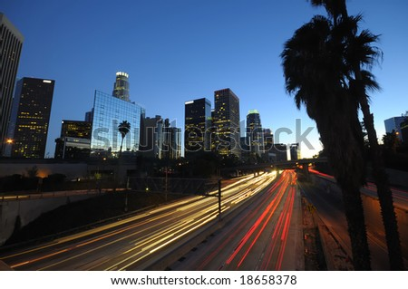 Los Angeles skyline and traffic on highway 110 at night - stock photo