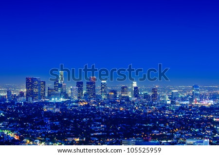 Los Angeles skyline at night with a clear sky.