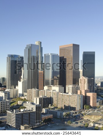 Los Angeles skyline at sunrise on a bright, sunny day.