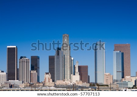 Los Angeles skyline on a sunny day with blue sky.