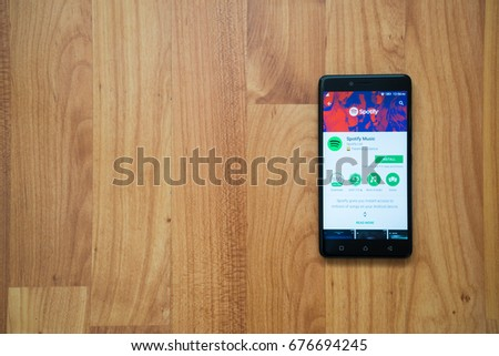 Los Angeles, USA, july 13, 2017: Spotify application on smartphone screen on wooden background. #676694245