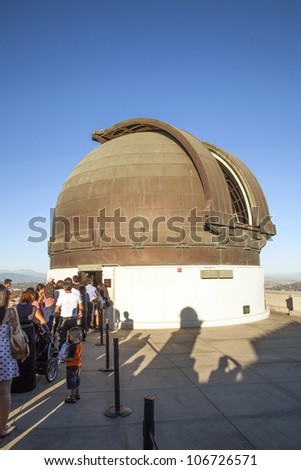 LOS ANGELES, USA - JUNE 24: Griffith observatory is open to watch the moon on June 24, 2012 in Los Angeles, USA. People  watch the moon with the famous  12-Inch Zeiss Refracting Telescope from 1931.