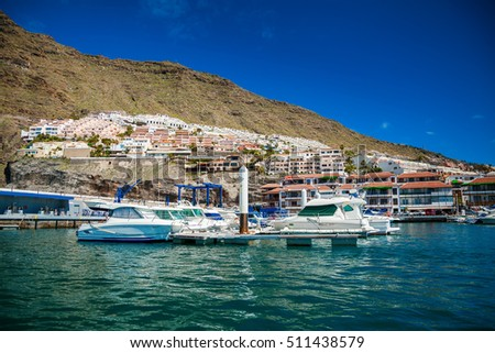 Los Gigantes harbor with its small houses and yachts, Tenerife, Spain