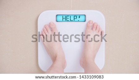 Lose weight concept with woman on a scale shows help