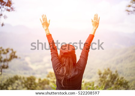 Lose woman happy feeling  good and strong  weight victorious facing on the natural mountain, Thailand.  Travel Concept