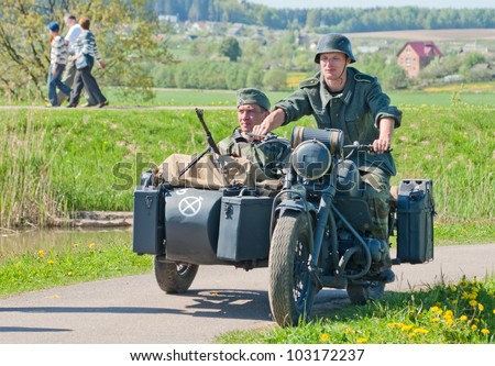 LOSHANY, BELARUS - MAY 9: military history club members in German WWII uniform ride a BMW R12 bike during historical reenacting show at Stalin's Line memorial on May 09, 2012 in Loshany, Belarus - stock photo