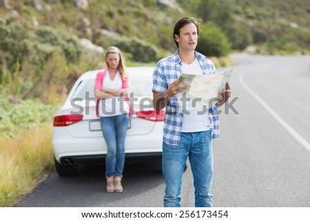 Lost couple at the side of the road