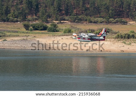 Lost Creek Lake, Oregon  - September 7 : Supperscooper plane after scoping water out of Lost Creek Lake to fight the 790 Fire, September 7 2014 in Lost Creek Lake, Prospect Oregon