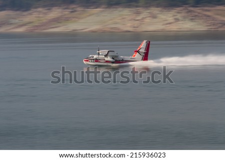 Lost Creek Lake, Oregon  - September 7 : Supperscooper plane scoping water out of Lost Creek Lake, September 7 2014 in Lost Creek Lake, Prospect Oregon