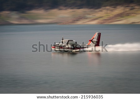 Lost Creek Lake, Oregon  - September 7 : Supperscooper plane scoping water out of Lost Creek Lake to fight the 790 fire, September 7 2014 in Lost Creek Lake, Prospect Oregon