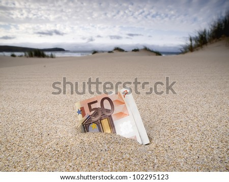 Lost fifty euros bill on the beach and buried in the sand