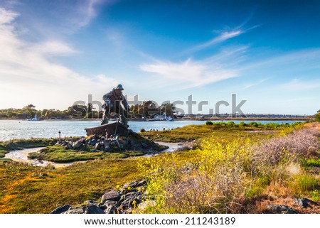 Lost Fisherman's Memorial in the Woodley Island, Eureka, California. View of the highway over the Indian Island at sunset